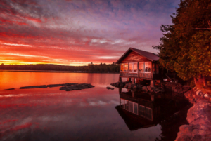 Lodge on a lake in the sunset